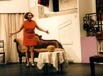Carol Melkett in Black Comedy